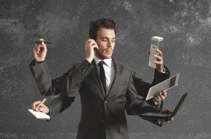Multitasking-man-in-business-suit-907x600-300x198